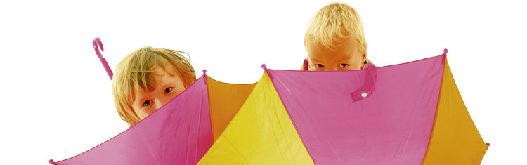Two young children with Home-Start umbrellas.